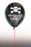 The words sovereign   debt in white and a skull and cross bones on a balloon illustrating the concept of a debt bubble Stock Images