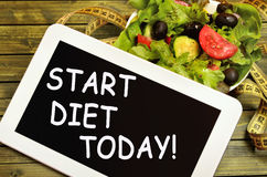 The words Start diet today on tablet Stock Image