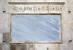 Words on stone. Facade of the cathedral of Modena. Italy Royalty Free Stock Photo