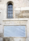 Words on stone. Facade of the cathedral of Modena. Italy Royalty Free Stock Photos