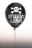 The words student loans in white and a skull and cross bones on a balloon illustrating the concept of a debt bubble. The words student loans and a skull and stock images