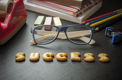 The words: success made of cookies. The words: success made of cookies, glasses and stationeries on table, lomo style Royalty Free Stock Photography