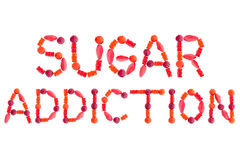 Words SUGAR ADDICTION made of red sugary candies Royalty Free Stock Images