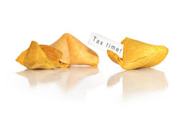 Words tax time in a fortune cookie. A mis-fortune cookie with a tax time reminder royalty free stock image