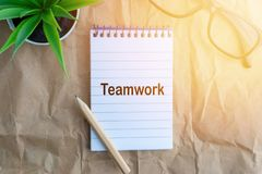 Words TEAMWORK on wooden paper background. Business and education concept stock photos