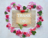 The words THANK YOU. Flower composition with words THANK YOU in the form of a heart- background Royalty Free Stock Photo