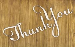 Words thank you on wooden texture background.  stock images