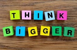 The words Think Bigger on table Royalty Free Stock Photography