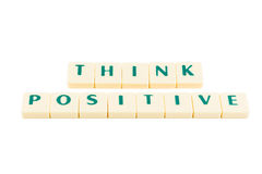 Words THINK POSITIVE. Letters forming the words THINK POSITIVE on a white background stock image