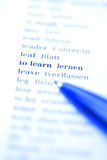 The words to learn on white paper. (selective focus tinted in blue Royalty Free Stock Photography