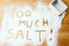 Words TOO MUCH SALT handwritten on salt Royalty Free Stock Images