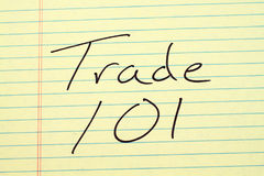 Trade 101 On A Yellow Legal Pad Royalty Free Stock Images