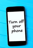 The words Turn off your phone Royalty Free Stock Photography