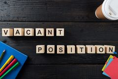 Words VACANT POSITION on a wooden blocks. Human Resources and personnel hiring concept. In a natural light royalty free stock photo