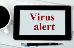 The words Virus alert on digital tablet Royalty Free Stock Photography