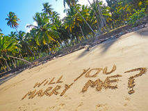 Words Will you marry me. On a beach Stock Images
