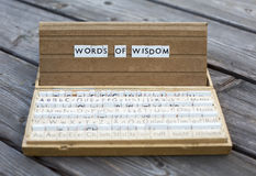 Words of wisdom. The words words of wisdom on an old school letter box royalty free stock images