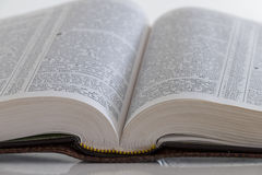 Words of wisdom. An open bible on a table royalty free stock photo