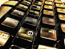Words of wisdom and technology. Keyboard, black and white, gold, old, retro, keyboard royalty free stock photos