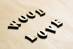 The words Wood and Love on a vintage wooden background stock images