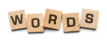 Words Wood Tiles. Words Spelled with Wood Tiles Isolated on a White Background Royalty Free Stock Images
