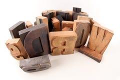 Words in wood. Words written among wooden typescript letters Stock Image