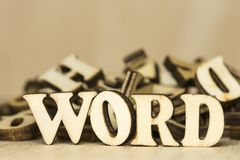 The words word on a wooden background carved from plywood.  stock photos