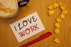 Word writing text I Love Work. Business concept for To be happy satisfied with job Be doing what you most likeIdeas on paper red p. Words writing texts I Love royalty free stock photography