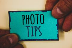 Word writing text Photo Tips. Business concept for Suggestions to take good pictures Advices for great photosgraphyMan hold holdin. Words writing texts Photo royalty free stock photos