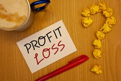 Word writing text Profit Loss. Business concept for Financial year end account contains total revenues and expensesIdeas on paper. Words writing texts Profit stock images
