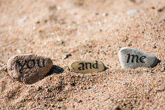 Words written in ink on the stones. With blurred background Royalty Free Stock Photo