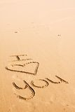 Words written in the sand. The words I love you written on the beach sand Royalty Free Stock Images