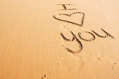 Words written in the sand. The words I love you written on the beach sand Royalty Free Stock Photos