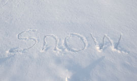 Words written in the snow Royalty Free Stock Photos
