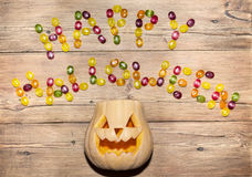 The words 'happy Halloween' from the candy and pumpkins Royalty Free Stock Images