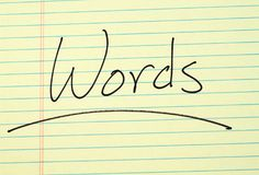 Words On A Yellow Legal Pad Royalty Free Stock Photography