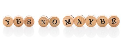 Words Yes No Maybe from circular wooden tiles with letters children toy. stock photography