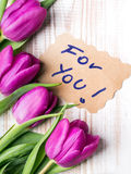 Words FOR YOU and bouquet of tulips Stock Photo