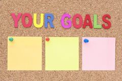 Words your goals with notepad Royalty Free Stock Image