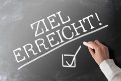 Words ZIEL ERREICHT, German for goal accomplished,  with checkmark on chalkboard. Words ZIEL ERREICHT, German for goal accomplished,  with checkmark on stock photos