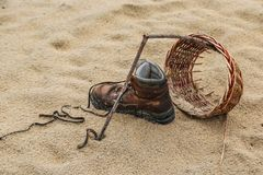 Wore out shoe on a beach Royalty Free Stock Image