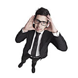 Woried nerd businessman. Funny portrait of a young businessman with a nerd glasses Stock Photo
