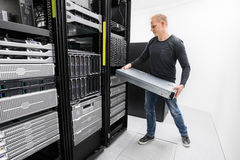 Woring IT consultant install rack server Royalty Free Stock Images