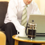 At work. Business man sitting in his hotel room on the laptop Royalty Free Stock Photography