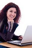Work. Beautiful redhead with laptop over white background Stock Images