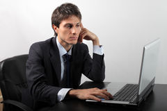 Work. Businessman at work sitting in front of a laptop Royalty Free Stock Images