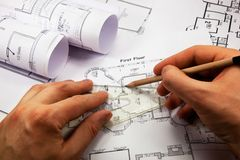 During work. Architect's hands with pencil and ruler during work Stock Images