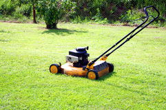 After the work. Grass cutting machine in a garden after the work Stock Images