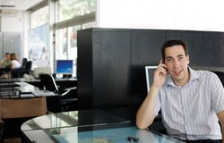 At work. Young businessman in the working environment stock photo
