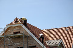 At work. Roofers at work Stock Images